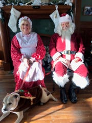 During the White Christmas at the Toledo and Ohio Central Depot, Joyce and Mike Schifer brought their dog Jasmine along providing cheer on October 19.