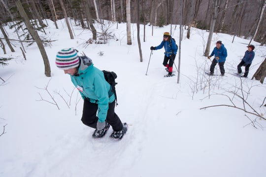 Snowshoers hike uphill on a trail at Mad River Glen on Jan. 29, 2017.