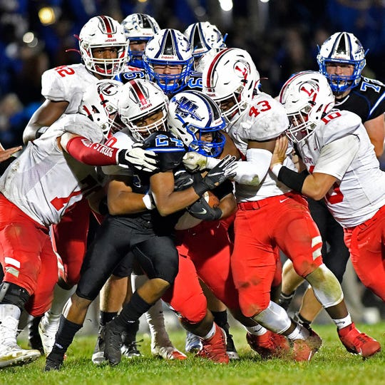 Williamstown's Lorenzo Rodriguez-Hines is brought down by Lenape's defense during Friday night's game at Williamstown High School. The Braves topped the Indians, 28 - 21, on Sept. 27, 2019.