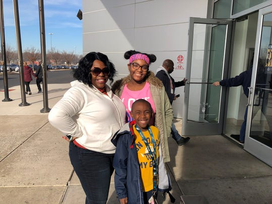 Inaya Badie of Camden visits the Cherry Hill Mall on Monday with her daughter, Kallure Standard, 15, and her son, CJ Standard, 8. Badie said the mall's parental escort policy for Dec. 26 isn't 'a bad thing.'
