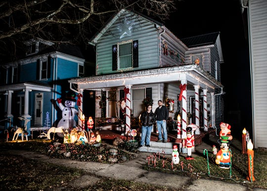 """Jason Adkins and his son Ben won the Griswold category of the city's holiday lighting contest for their """"National Lampoon's Christmas Vacation"""" inspired lighting display."""
