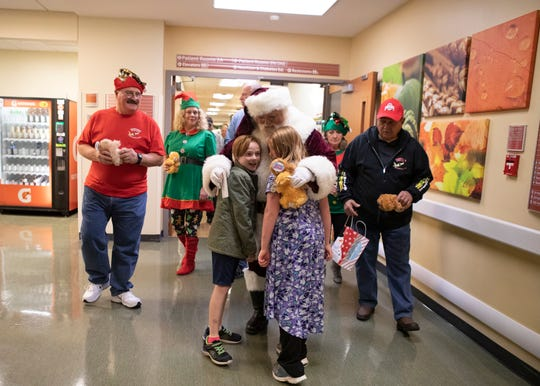 Nick Rose greats siblings Conner and Kylynn as Santa Claus at Adena Regional Medical Center on Thursday, Dec. 19, 2019. Rosa and the Igniters Street Rods organization have been visiting the hospital and handing out bears for almost 20 years.