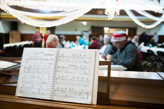 "Veterans sang along with various Christmas carols like ""Let is snow"" after a dinner at the Chillicothe Elks Lodge."