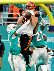 Dec 22, 2019; Miami Gardens, Florida, USA; Cincinnati Bengals tight end Tyler Eifert (85) makes a catch for a touchdown against the Miami Dolphins during the second half at Hard Rock Stadium.