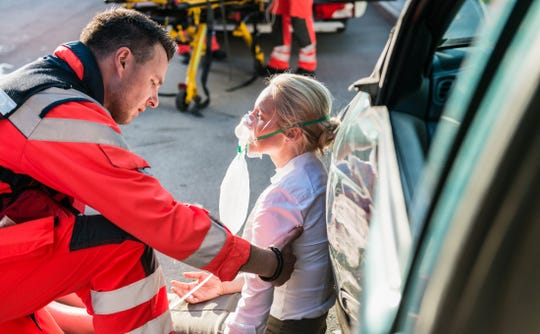 EMTs offer life-saving care at the scene of an accident.