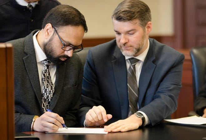 Gurpreet Singh, accused of shooting and killing his wife, and three in-laws in April 2019, confers with his lead attorney, Neal Schuett, in Judge Gregory J. Howard's Butler County courtroom in Hamilton on Monday, Dec. 23, 2019. His trial date is now moved to October, 2022 to allow attorneys time to obtain documents from India.