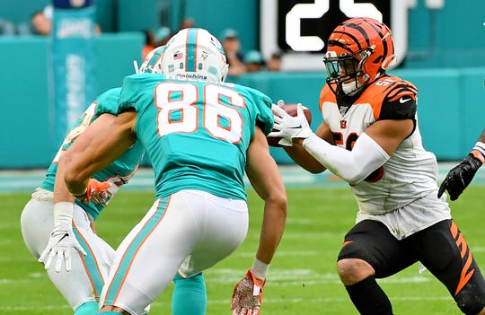 Dec 22, 2019; Miami Gardens, Florida, USA; Cincinnati Bengals middle linebacker Hardy Nickerson (56) recovers an onside kick against the Miami Dolphins during the second half at Hard Rock Stadium.