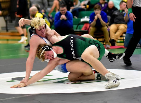 Mason's Owen Amburgy and Walton-Verona's Daulton Mayer stretch things out in their first-place bout in the 195 lbs. class at the 2019 Glenn Sample Southwest Ohio Coaches Classic Wrestling Tournament, Dec. 22, 2019.