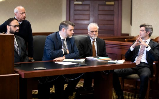 Gurpreet Singh, left, accused of shooting and killing his wife, and three in-laws in April 2019, sits while his team of layers, from right, Charlie M. Rittgers, Charlie H. Rittgers, and Neal Schuett discuss their case during his arraignment in Judge Gregory J. Howard's Butler County courtroom in Hamilton on Monday, Dec. 23, 2019.