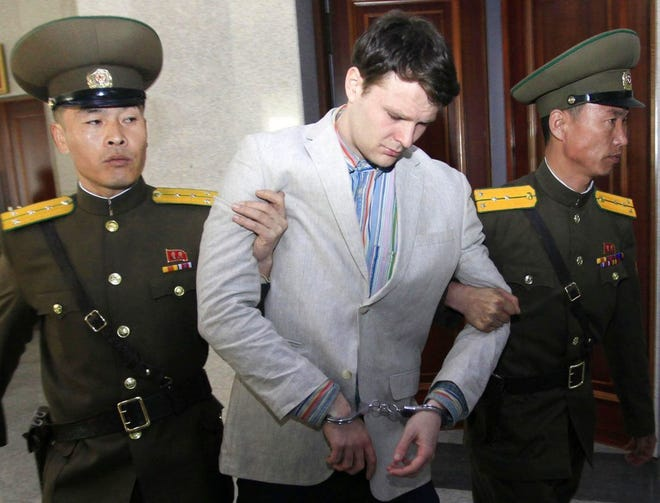 Otto Warmbier is escorted at the Supreme Court in Pyongyang, North Korea. The 22-year-old died last year.