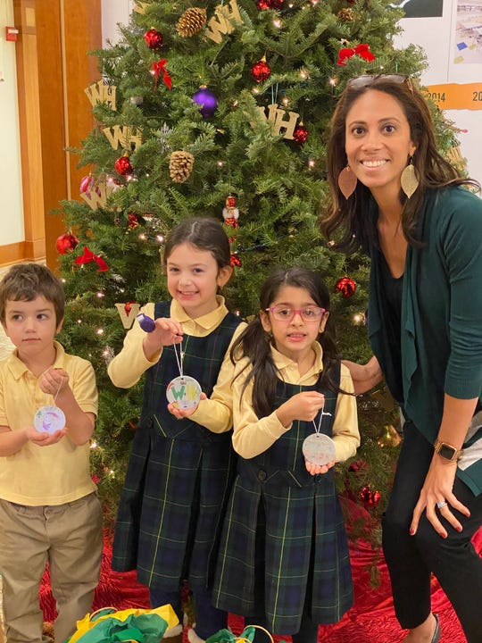 The Wardlaw+Hartridge School in Edison announced this year's Lower School Ornament contest winners. Students were required to decorate an ornament with W+H spirit recognizing the holiday of their choice. Congratulations to Auden Rubin of Scotch Plains, Leah Alves of Springfield and Riya Chaturvedi of Edison, who are pictured by the tree in the main reception area with Silvia Davis of Metuchen, Lower School Head.
