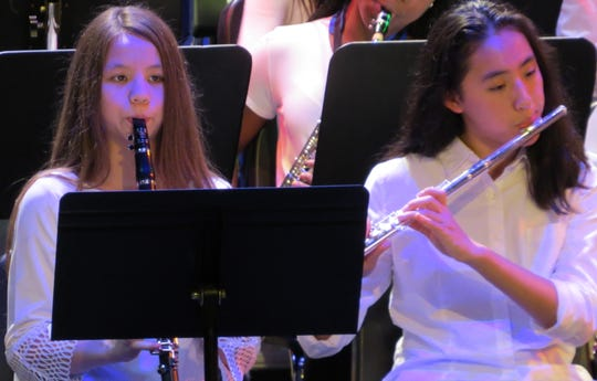 Phoebe Kaplan and Hannah Yin, both of Scotch Plains, perform in the seventh and eighth grade band.
