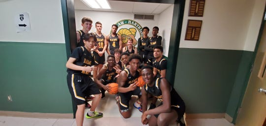 The W+H boys' basketball team gathers for a team photo before making a grand entrance at the inaugural Laidlaw Lights.