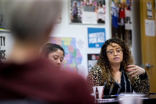 Chelsea Chism-Vargas speaks during a Citizens for Community Improvement potluck on Thursday, Dec. 19, 2019, in Des Moines.