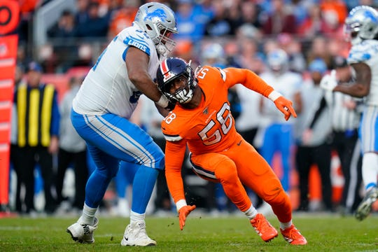 Broncos outside linebacker Von Miller spins around Lions offensive tackle Tyrell Crosby during the second half of the Lions' 27-17 loss on Sunday, Dec. 22, 2019, in Denver.