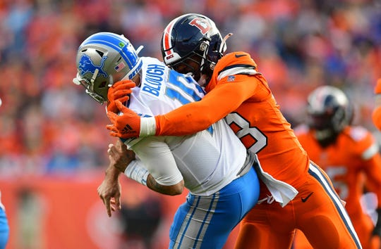 Broncos linebacker Malik Reed hits Lions quarterback David Blough in the second quarter of the Lions' 27-17 loss on Sunday, Dec. 22, 2019, in Denver.