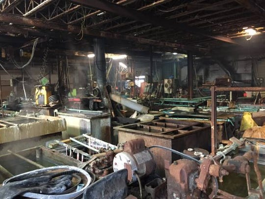 This photo provided by the Michigan Department of Environmental Quality showed conditions in 2017 inside Electro-Plating Service on 10 Mile Road in Madison Heights, which has since been cleaned up as an EPA Superfund site.