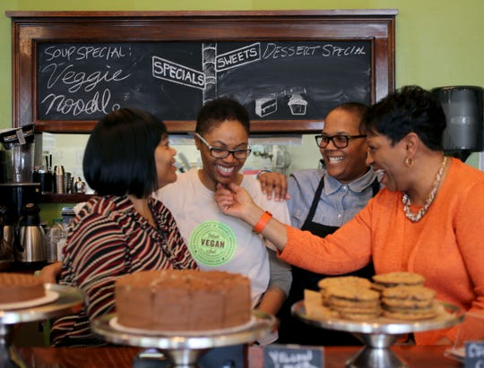 Pastry Chef Irene Pegram, left, with her daughter Kirsten Ussery-Boyd, co-owner of Detroit Vegan Soul with her partner Erika Boyd, and Erika's mother Jeanette Girty, at their restaurant in May 2016.