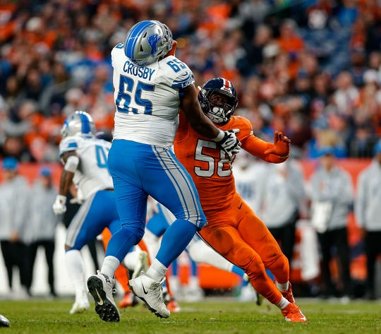Broncos outside linebacker Von Miller rushes against Lions offensive tackle Tyrell Crosby in the fourth quarter of the Lions' 27-17 loss on Sunday, Dec. 22, 2019, in Denver.