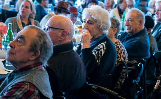 Survivors of the Holocaust and others listen to remarks as they gather at the Museum of Jewish Heritage in New York Sunday, Dec. 22, 2019, to recognize International Holocaust Survivors Night, one of several events held around the world.