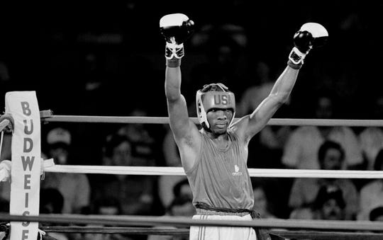 Pernell Whitaker of Norfolk, Va., raises his arms in victory after defeating Clifford Gray of Boynton Beach, Fla., in the Olympic boxing trials in Fort Worth, Texas, June 7, 1984.