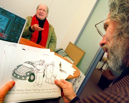 Cartoonist Gahan Wilson gestures as New Yorker cartoon editor Robert Mankoff looks over Wilson's offerings at the magazine's offices in New York.