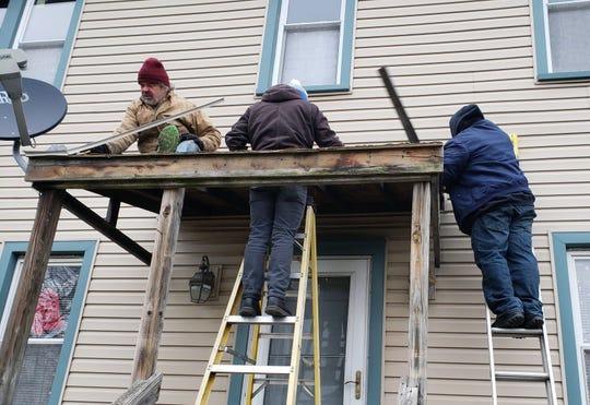 TimeBank members performing maintenance and repairs on a member's home.