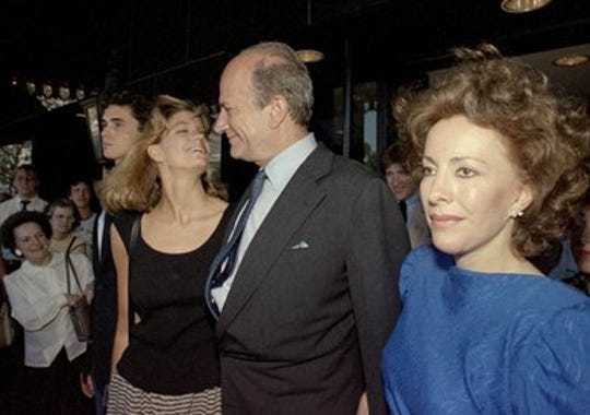 Claus von Bulow is pictured with his daughter Cosima, left, and his companion Andrea Reynolds, in Providence, R.I., after being acquitted for the attempted murder of his wife,  June 10, 1985.