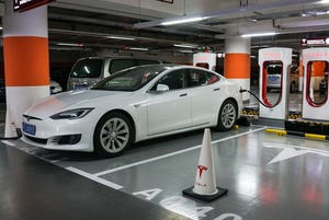 A Tesla vehicle is parked at a charging station inside a mall in Shanghai in this October 23, 2017, file photo.
