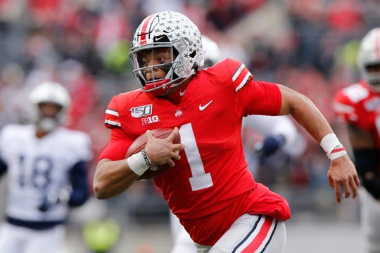 Justin Fields, a sophomore and Ohio State's Heisman Trophy finalist quarterback, said online classes allow him to split his time between studying at home or relaxing with Netflix and the Woody Hayes Athletic Center.