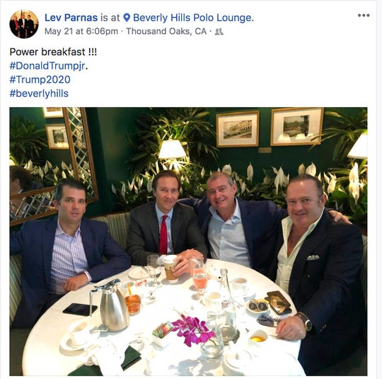 This file Facebook screen shot provided by The Campaign Legal Center shows, from left, Donald Trump Jr., Tommy Hicks Jr., Lev Parnas and Igor Fruman, posted on May 21, 2018.