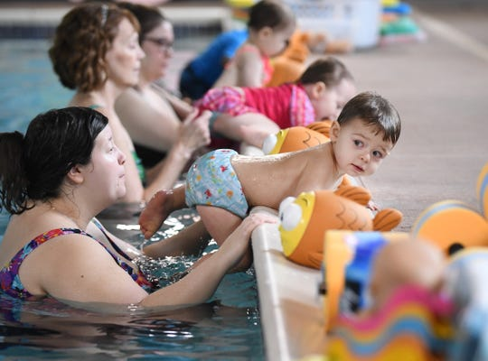 Christina Korte works with her son Ryan, 2, during a swim lesson at Goldfish Swim School in Canton.