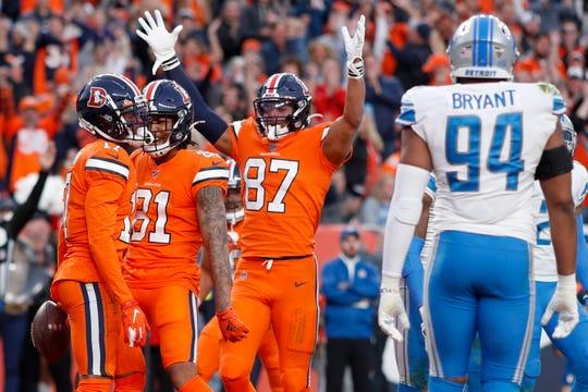 Broncos wide receiver DaeSean Hamilton, left, celebrates his touchdown against the Lions.