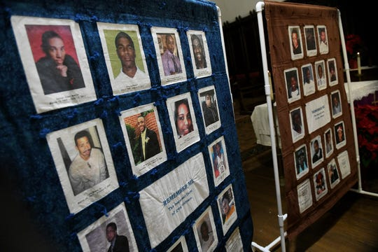 Photos of some the people who have been killed by gun violence are displayed at a service for Fallen Angels at Church of the Messiah in Detroit on Sunday.