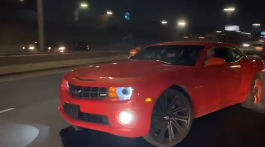 A Camaro does doughnuts on I-94 in Detroit.