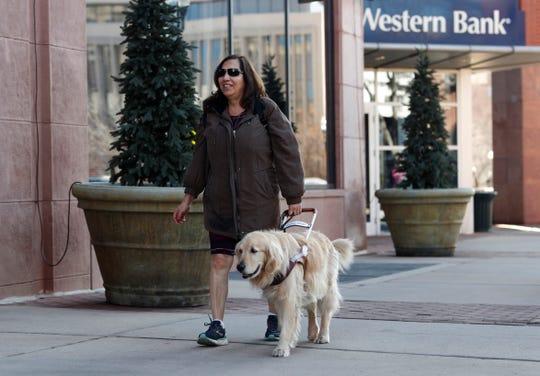 Colorado Springs, Colo., city council member Yolanda Avila walks through the streets of downtown Colorado Springs, Colo.