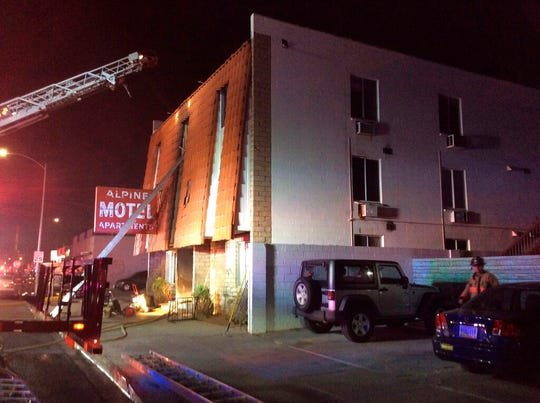 This photo provided by the Las Vegas Fire Department, firefighters work the scene of a fire at a three-story apartment complex early Saturday, Dec. 21, 2019 in Las Vegas.