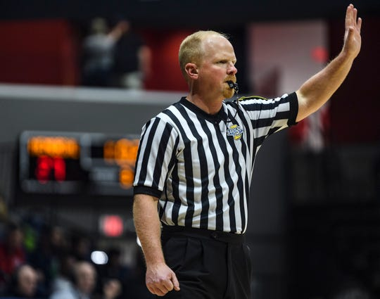 David George, an Indiana High School Athletics Association referee, officiates during the River City Showcase game between the Barr-Reeve Vikings and Memorial Tigers at Screaming Eagles Arena in Evansville, Ind., Tuesday, Dec. 10, 2019.