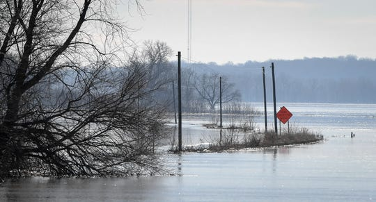 With the Ohio River at nearly 40 ft. on the Evansville gage Water Works Road is under water Monday, December 23, 2019.