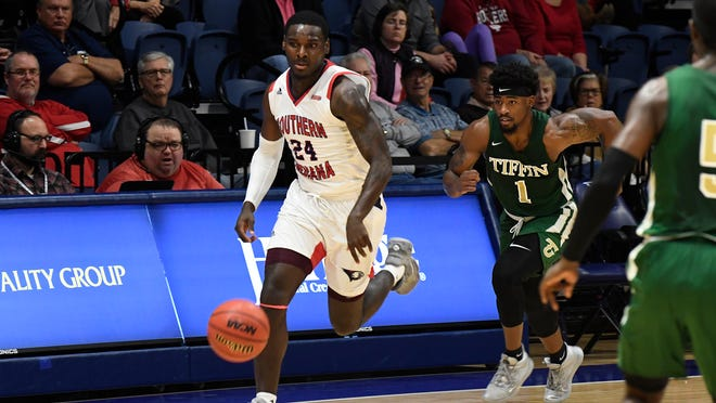 Darnell Butler, who scored 18 points and grabbed 13 rebounds on Sunday, dribbles upcourt against Tiffin.