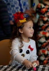 Eloise Laramie, 4, of Henderson, Ky., plays dreidel at a Hanukkah celebration at Temple Adath B'Nai Israel in Evansville Sunday morning, Dec. 22, 2019.