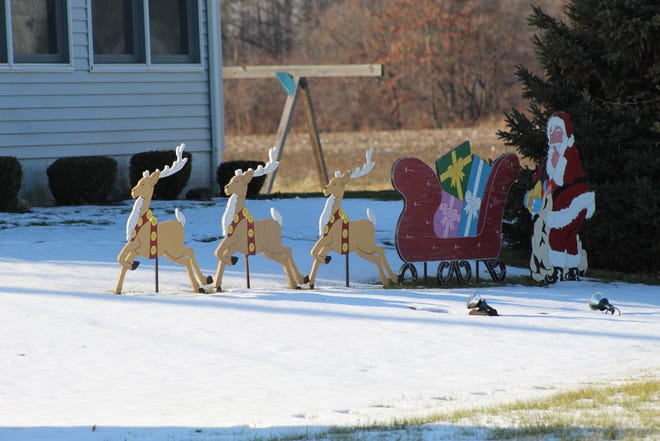 Snow began melting away Dec. 21 as temperatures rose to unseasonable heights.