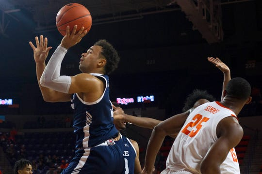 Dec 22, 2019; Clemson, South Carolina, USA; Yale Bulldogs guard Azar Swain (5) goes in for the shot while being defended by Clemson Tigers guard Aamir Simms (25) during the first half of the game at Littlejohn Coliseum. Mandatory Credit: Joshua S. Kelly-USA TODAY Sports