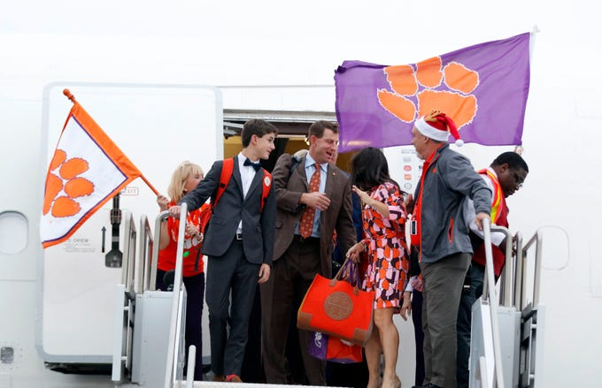 Clemson's coach Dabo Swinney and his wife Kathleen arrive at Phoenix Sky Harbor Executive Terminal in Phoenix, Sunday, Dec 22, 2019 for the 2019-20 PlayStation Fiesta Bowl.