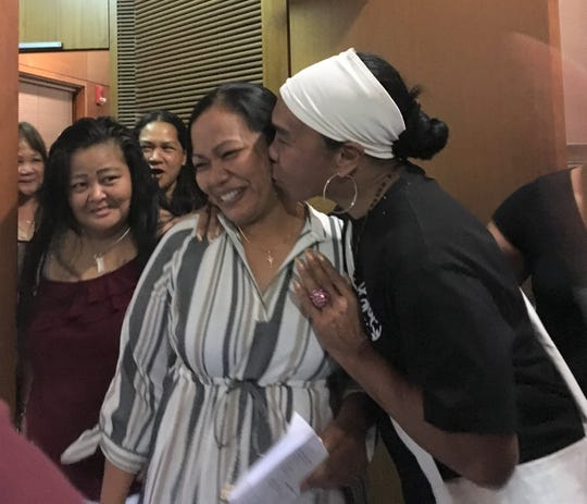 Loved ones surround Roxanne Hocog after Judge Anita Sukola suspended her prison sentence Monday, Dec. 23, 2019. She previously pleaded guilty to various drug related cases. She spent about two years working with Oasis Empowerment Center to battle her drug addiction.