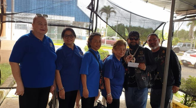VFW Auxiliary Post 1509 donated to Guam Hawks Motorcycle Club on Dec. 1 to go towards their holiday island runs for toys/candies for tots. Shown are:  Doris Cruz VFW Aux trustee, Annie Payne VFW Aux secretary, Vicky Sanchez VFW Aux member, Rosie S Fejeran VFW Aux president, Roland Ada GHMC president and Andy Carillo GHMC vice president.