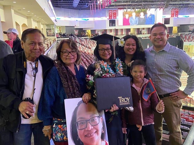 Jenny Casil Natalicio, originally from Tamuning, now living in Tipp City, Ohio, graduated with a master's degree in human resource management from Troy University, Troy, Alabama on Dec. 13. Pictured from left: Her parents Leo and Evelyn Casil of Tamuning, Jenny Casil Natalicio, Jenny's daughters Erica and Emilee Natalicio and her husband Eric Natalicio all of Tipp City, Ohio. She is employed as a human resource specialist at Wright Patterson Air Force Base.