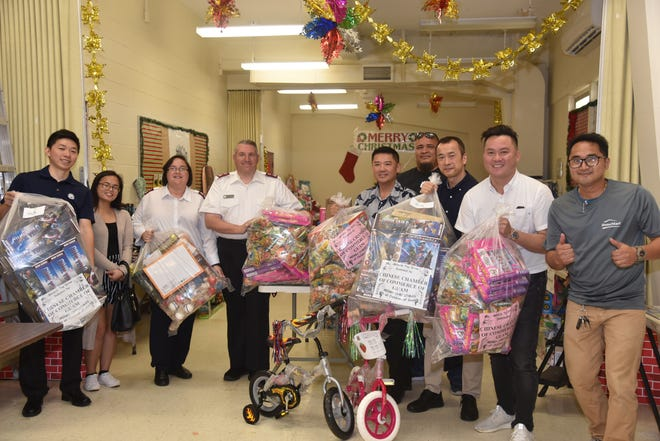 The Chinese Chamber of Commerce of Guam recently delivered $10,000 worth of toys to the Salvation Army — just as it's done for the past 10 years. Pictured from left: Jianhui Qin, CCCG board of directors, Janenalyn Affleje, Major Kim and Major Tom Stambaugh of Salvation Army, Benson Au-Yeung, CCCG PP and board of directors, Gilbert Manibusan, Kwong Hwa Home Mart staff, Peter Lai, vice president of Quality Distributors, Jack Chan, CCCG vice president/president of Kwong Hwa Home Mart, and Alfred Leal, Kwong Hwa Home Mart staff.