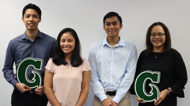 University of Guam accounting students (from left) Giovanni Aldan, Starr Perman, and Mark Natividad took first place in the Government Finance Case Challenge of the Association of Government Accountants. Also shown is their accounting professor, Doreen Crisostomo.