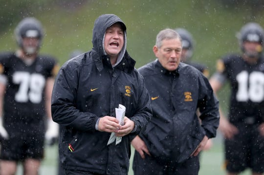 Iowa offensive coordinator Brian Ferentz, left, and his father, head coach Kirk Ferentz, are shown during a pre-Holiday Bowl practice in San Diego.